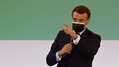 French President Emmanuel Macron gestures as he speaks during the One Planet Summit, part of World Nature Day, at the Reception Room of the Elysee Palace, in Paris.