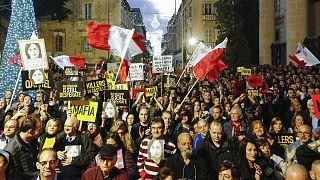 People stage a protest in Valletta, Malta, Sunday, Dec. 1, 2019.