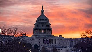 Dawn breaks at the Capitol in Washington, Monday, Jan. 11, 2021.