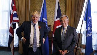 Britain's Foreign Secretary Boris Johnson, left, poses for a photograph with UN Secretary General Antonio Guterres