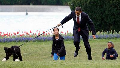 Obama and his dog Bo in the White House gardens