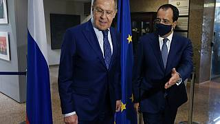 Russian Foreign Minister Sergey Lavrov, left, is greeted by his Cypriot counterpart Nikos Christodoulides