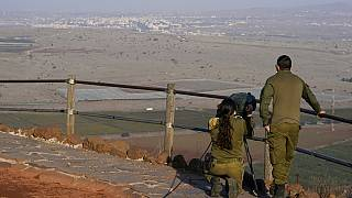 Israeli soldiers observe Al Qunaitra, Syria, across the border from Mount Bental in the Israeli-controlled Golan Heights, Thursday, Nov. 19, 2020.