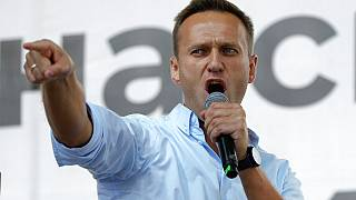 In this Saturday, July 20, 2019 file photo, Russian opposition activist Alexei Navalny gestures while speaking to a crowd during a political protest in Moscow