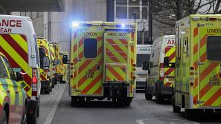 Ambulances queue outside the Royal London Hospital in London