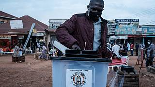 Ugandans Line Up to Cast their Ballots in Charged Election
