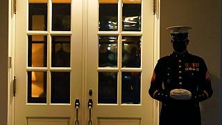 A Marine guard stands at the entrance to the West Wing of the White House, after the U.S. House impeached President Donald Trump in Washington, Wednesday, Jan. 13, 2021.