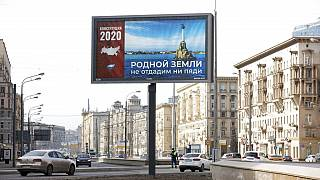 "A billboard with a picture of Sevastopol that reads: ""Not an inch of our Dear Land to be Surrendered"" is displayed in Moscow, Russia, Wednesday, March 25, 2020."