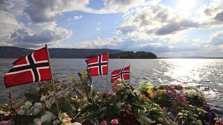 Norwegian flags and flowers are seen in Sundvollen, close to Utøya island.