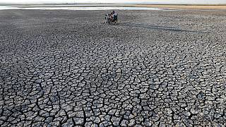 Cracked soil after a drought at Dikilitas Pond in the Golbasi district of Ankara in July 2020.