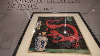 """اللوحة الأصلية  للفنان """" إيرجيه"""" بعنوان """"زهرة اللوتس الأزرق""""  للشخصية الكوميدية  """"تان تان"""""""