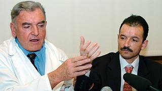 French Dr. Jean-Michel Dubernard, left, and France's Denis Chatelier hold a press conference at the Edouard Herriot hospital in Lyon, central France, Thursday, Jan.13, 2005