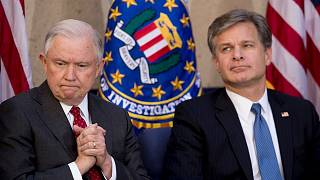 Attorney General Jeff Sessions sits with FBI Director Chris Wray