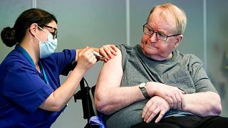 Svein Andersen was the first in Norway to receive the coronavirus vaccine in the capital Oslo, Sunday, Dec. 27, 2020.