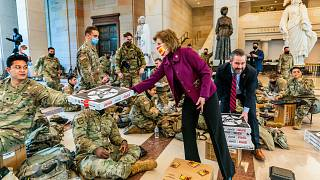 Pizzas are handed out to members of the National Guard gathered at the Capitol Visitor Center in Washington, USA, during the vote to impeach President Donald Trump. January 13