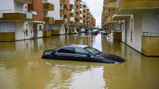 A car submerged on a flooded street in the town of Fushe Kosove after heavy rain and snow showers in Kosovo. January 11, 2021