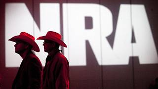 In this May 4, 2013, file photo, National Rifle Association members listen to speakers during the NRA's Annual Meetings and Exhibits in Houston, Texas.