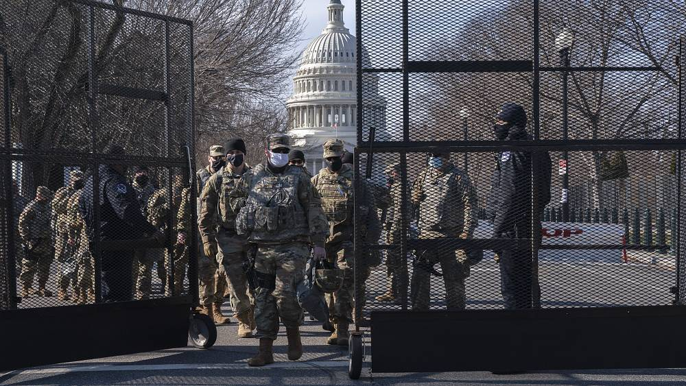 Biden inauguration: National Guard troops pour into Washington amid concerns over violent protests