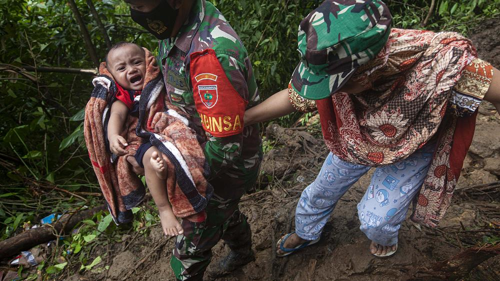 Indonesian rescuers retrieve more bodies from the rubble of buildings toppled by powerful earthquake