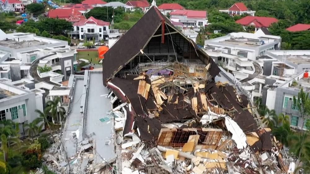 Number of bodies found after Indonesian earthquake rises to 56