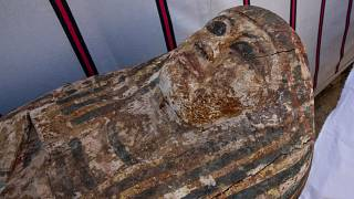 An ancient coffin unearthed in a vast necropolis filled with burial shafts, coffins and mummies dating back to the New Kingdom 3000 BC, Monday, Jan. 17, 2021, in Saqqara, sout