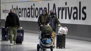 Travellers arrive at Heathrow Airport in London, Sunday, Jan. 17, 2021. Thousands of EU citizens were turned away from the UK border in the first quarter of 2021.