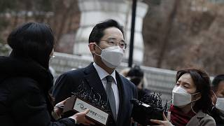 Samsung Electronics Vice Chairman Lee Jae-yong is questioned by reporters upon his arrival at the Seoul High Court in Seoul, South Korea, Monday, Jan. 18, 2021.
