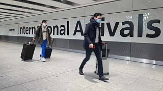 Passengers arrive at Heathrow airport the day before the UK government closes all travel corridors