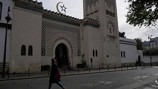 A woman walks outside the Paris mosque, Thursday, Oct. 29, 2020.
