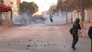 Police firing tear gas canisters, protesters throwing objects