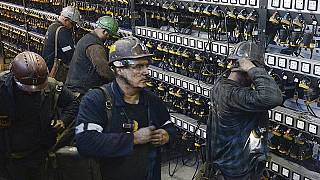 miners put away their equipment after an underground shift at the Wujek coal mine in Katowice, in Poland's southern mining region of Silesia
