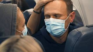 Alexei Navalny and his wife Yulia sit on the plane on a flight to Moscow, at the Airport Berlin Brandenburg (BER) in Schoenefeld, near Berlin