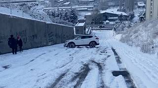 Car skidding down a hill