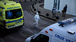 Ambulances parked outside the COVID-19 emergency ward at the Santa Maria hospital in Lisbon
