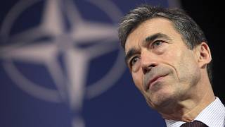 NATO Secretary General Anders Fogh Rasmussen addresses the media at NATO headquarters in Brussels, Friday Dec. 4, 2009.