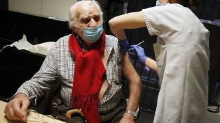 Mr Albert from Paris, 94 years old, receives the Pfizer-BioNTech vaccine against COVID-19 at a vaccination centre in Paris, Jan. 18, 2021.