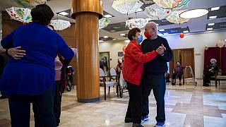 Tzvika Sermik, 92, right, and Virginia Wendel, 86, dance after they received their second Pfizer-BioNTech COVID-19 vaccine