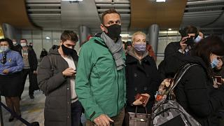 Alexei Navalny and his wife Yuliastand in line at the passport control after arriving at Sheremetyevo airport, outside Moscow, Russia, Sunday, Jan. 17, 2021.