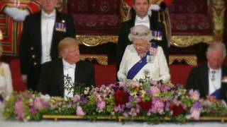 US president sitting next to the Queen of England