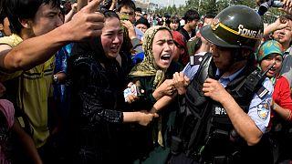 Doğu Türkistan'ın başkenti Urumçi'deki bir protesto (arşiv)