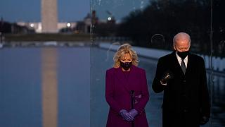 President-elect Joe Biden and his wife Jill Biden participate in a COVID-19 memorial event at the Lincoln Memorial Reflecting Pool, Tuesday, Jan. 19, 2021, in Washington