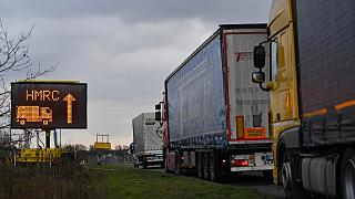 Freight trucks queue to enter the Waterbrook Park facility in Ashford, south east England on January 15, 2021, as hauliers get used to life under the post-Brexit trade deal.
