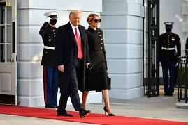 US President Donald Trump and First Lady Melania make their way to board Marine One before departing from the South Lawn of the White House in Washington, DC on January 20, 20