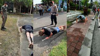 Bali'de maske takmayan turistlere şınav cezası
