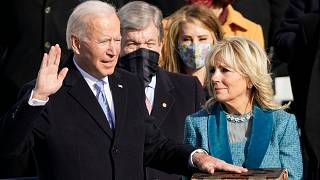 Joe Biden is sworn in as the 46th president of the United States as Jill Biden holds the Bible. U.S. Capitol in Washington, Wednesday, Jan. 20, 2021.