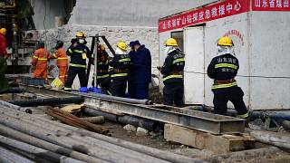 A rescue team working at the site of a gold mine explosion where more than 20 miners are trapped underground in Qixia, in eastern China's Shandong province, Jan. 20, 2021.