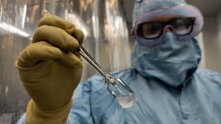 A technician shows a vial of the Cuban made COVID-19 vaccine called Soberana 2