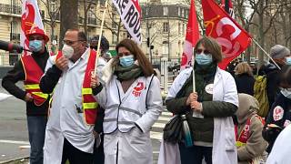 Health care workers protest outside the French health ministry in Paris, Thursday, January 21, 2021.