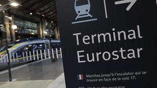In this Dec.21, 2020 file photo, an information board is displayed at Gare du Nord train station in Paris.