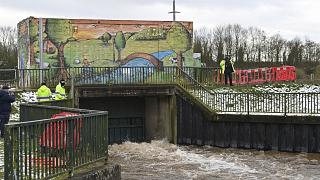 Environment Agency workers flood a storm basin near the River Mersey in Didsbury, north west England, to view flood defences put in place for Storm Christoph, Jan. 21, 2021.
